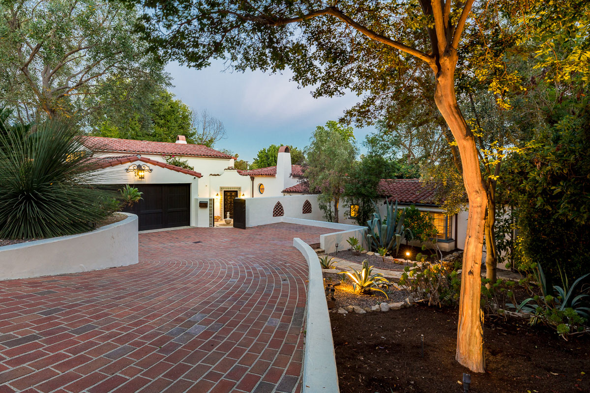brick driveway and Spanish home