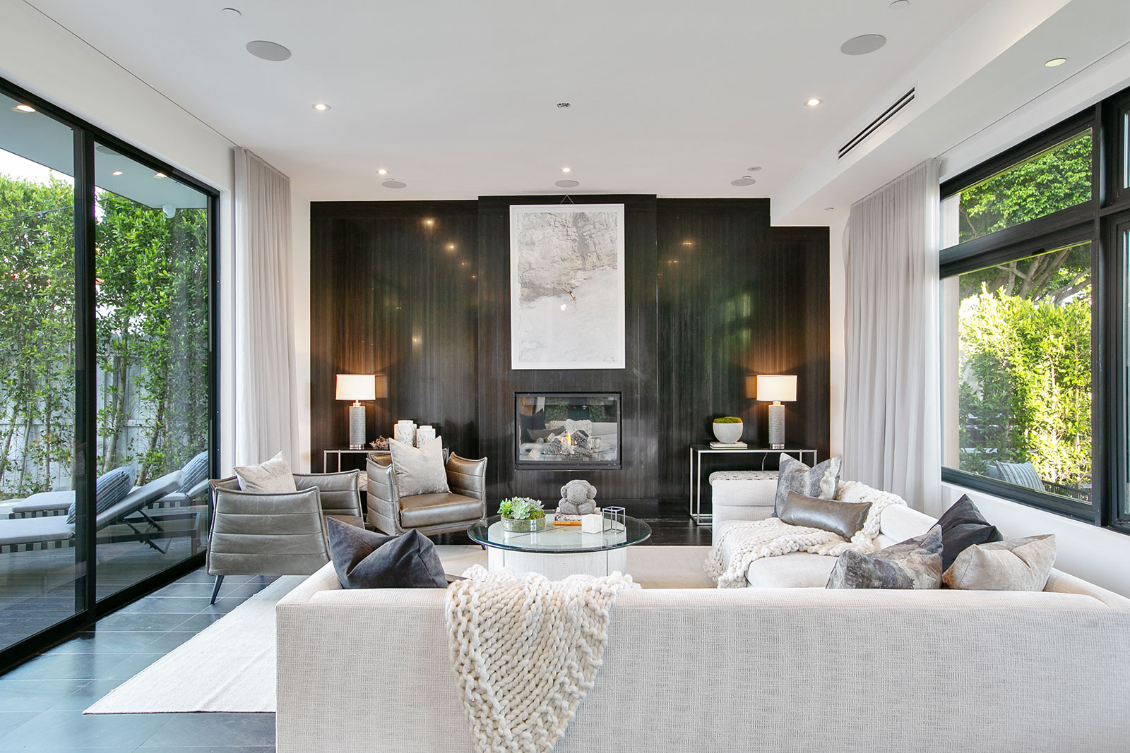 Fireplace and couch in Hollywood home