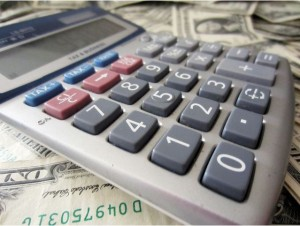 Image of a calculator on a pile of money