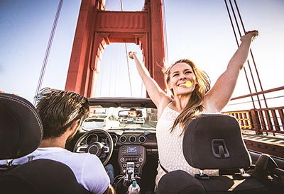 Couple driving on the Golden Gate Bridge.