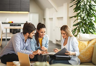 Young couple talking with a real estate professional