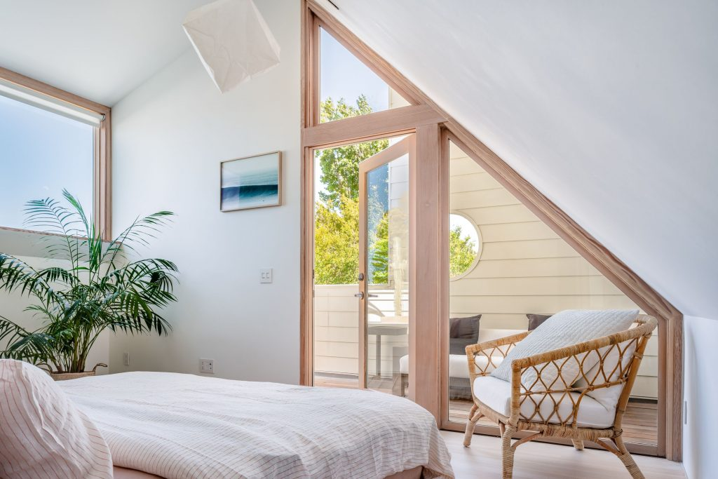 bedroom with angled windows