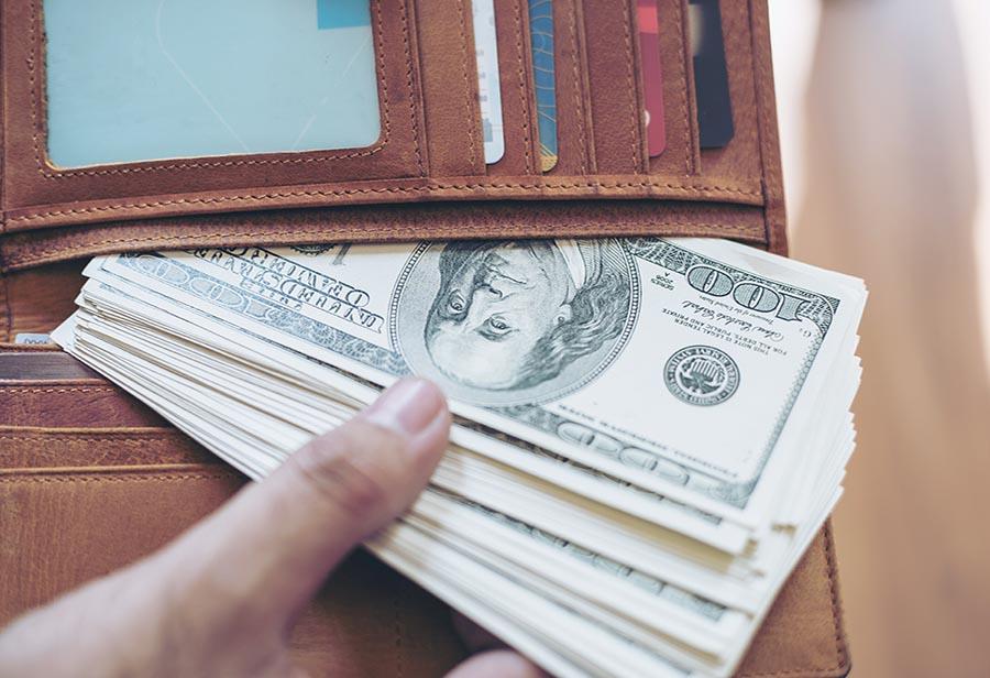 US dollar money banknote in full wallet