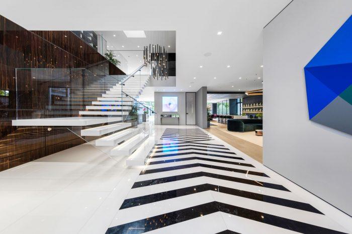 Malerba chandeliers grace a dramatic foyer.