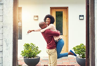 A young couple celebrating the move into their new house