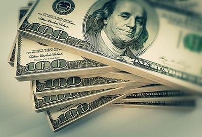 Stacks of one-hundred dollar bills