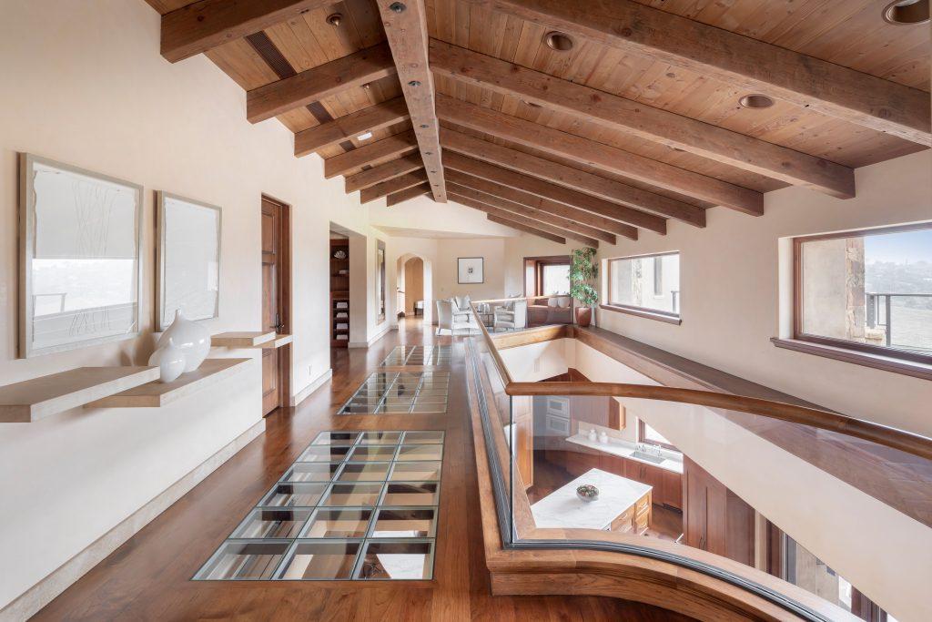 upstairs walkway with glass flooring