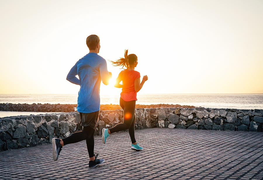 Health young couple jogging together