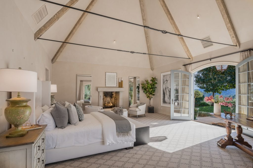 Bedroom with high ceilings.