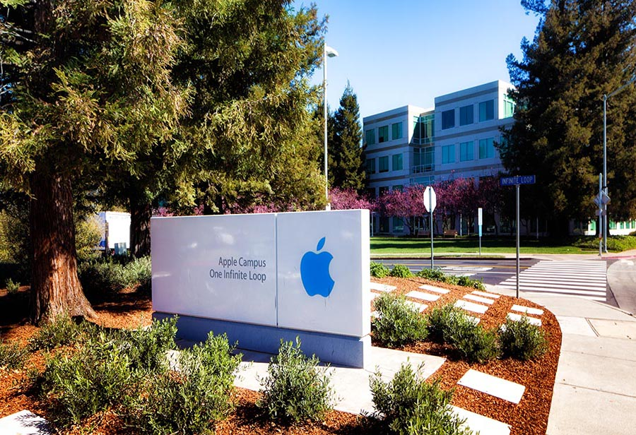 Apple headquarters campus entrance with infinite loop sign