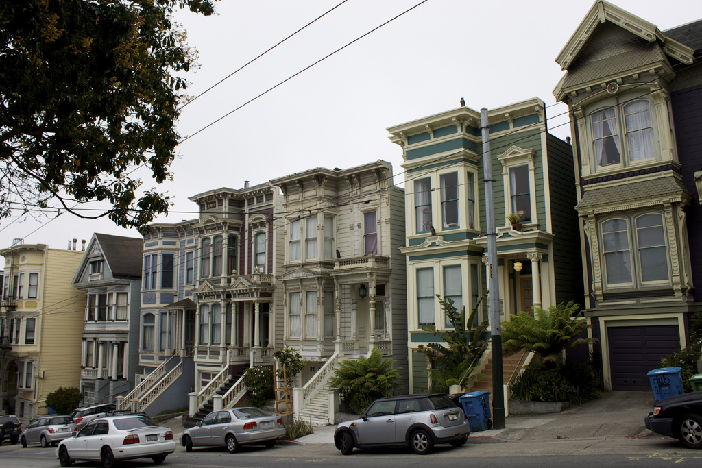 Photo of a row of pastel-color homes in San Francisco