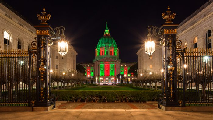 Civic Center San Francisco with green and red lighting.