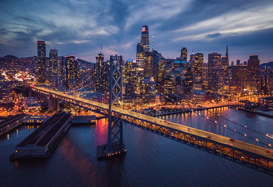 Aerial Cityscape view of San Francisco and the Bay Bridge at Night, California, USA