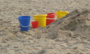 Photo of plastic buckets on a beach