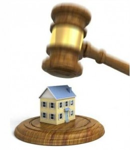 Illustration of a judge's gavel coming down on a house