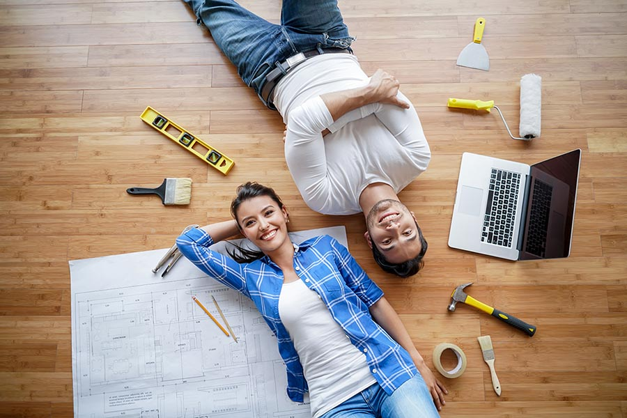 couple working on house - Pacific Union