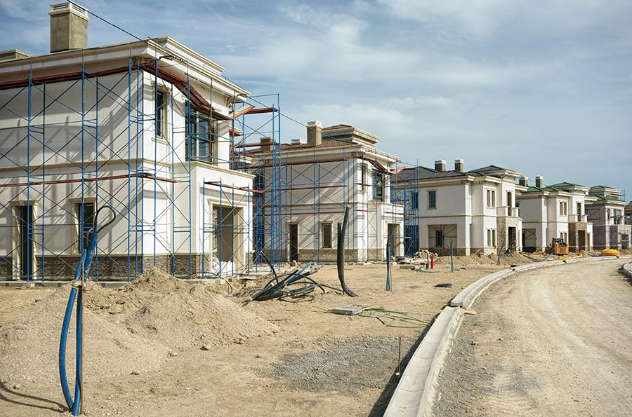 exterior shot of a construction site of a town house - Pacific Union
