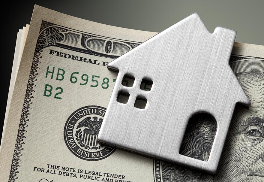 Dollar bills with miniature model house