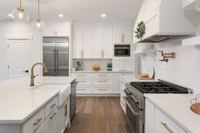 A clutter-free kitchen with plenty of cabinets and a walk-in pantr