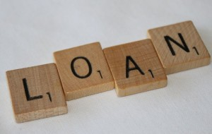 "Scrabble letters spelling the word ""loan"""