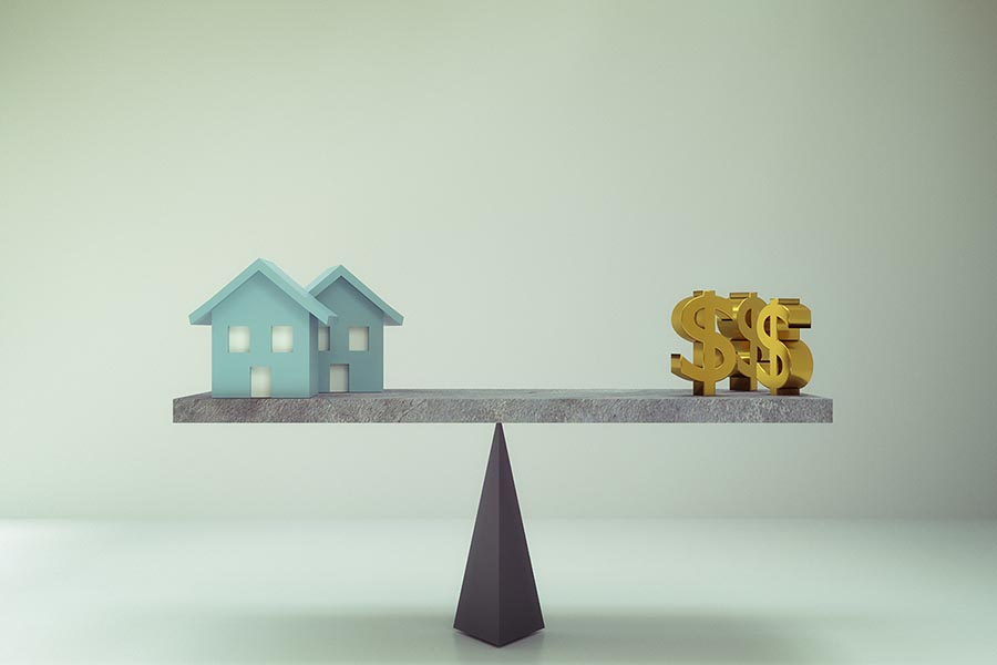 3D rendering of dollar sign with house on balance board