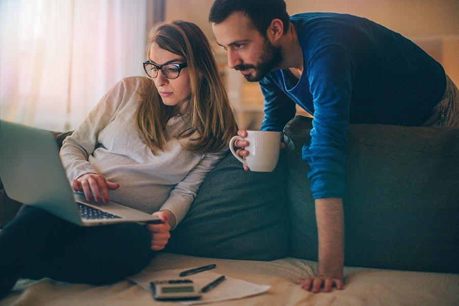 couple checking finances - Pacific Union