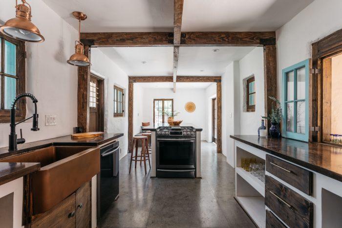 Kitchen in adobe home.