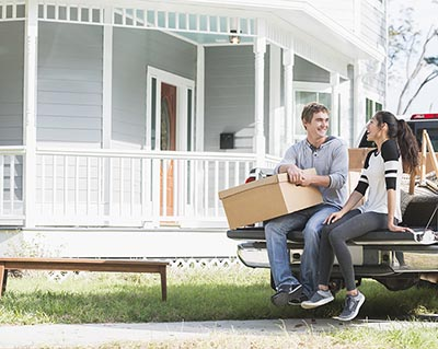 Young couple in moving truck